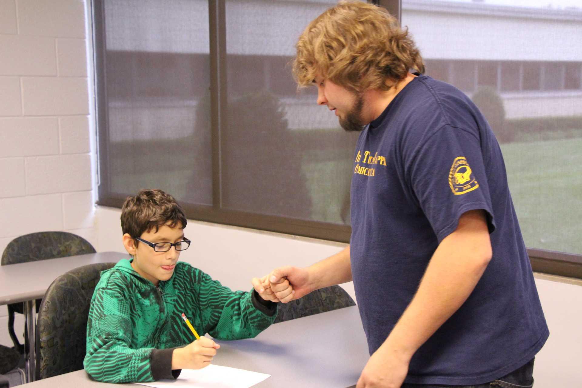 Steven Kliemann tutoring Middle School Student Jacob Sanders.