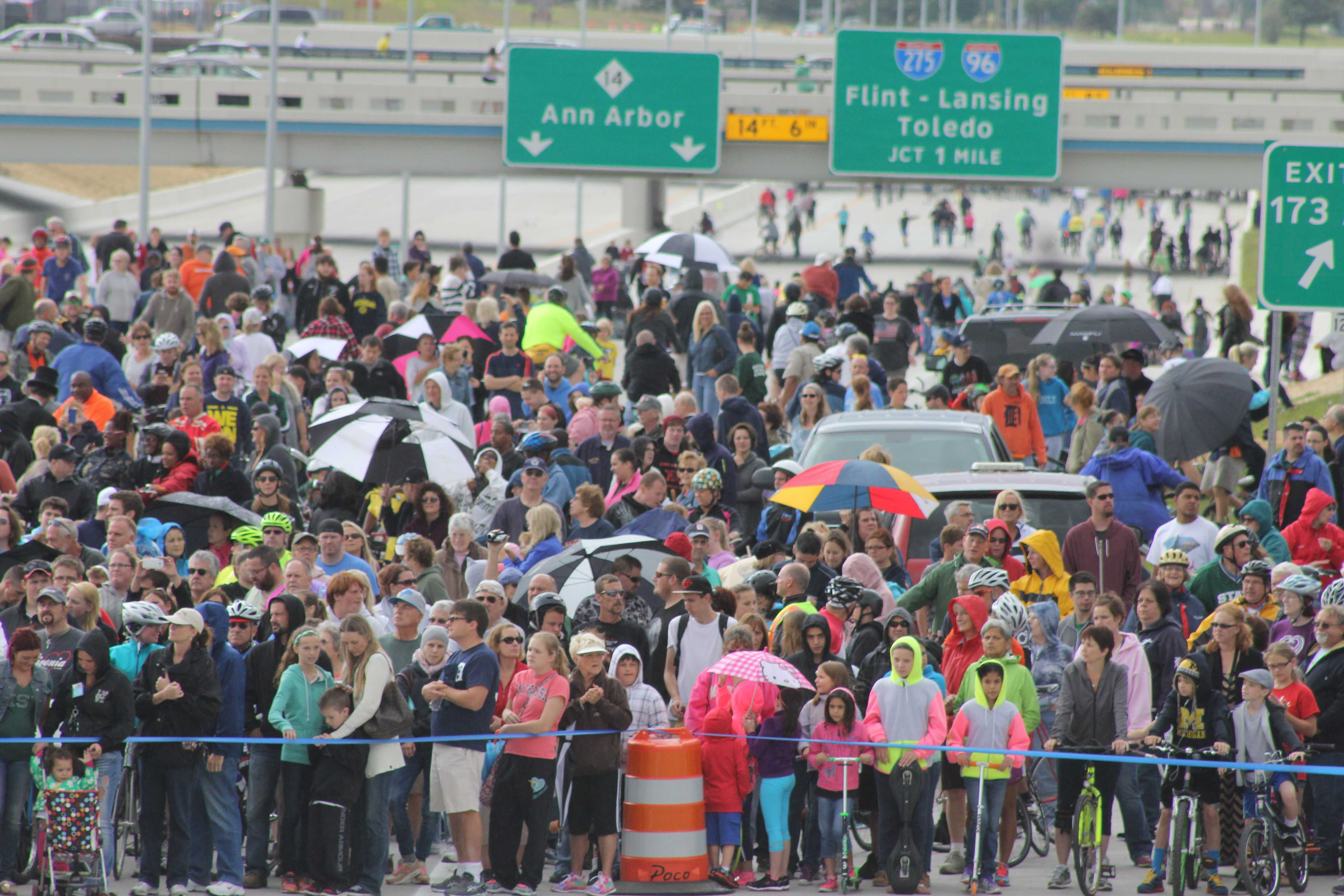 Local Residents wait in anticipation to walk on I-96 for the first time in over 40 years. Photo by Tyler Kabrovich.