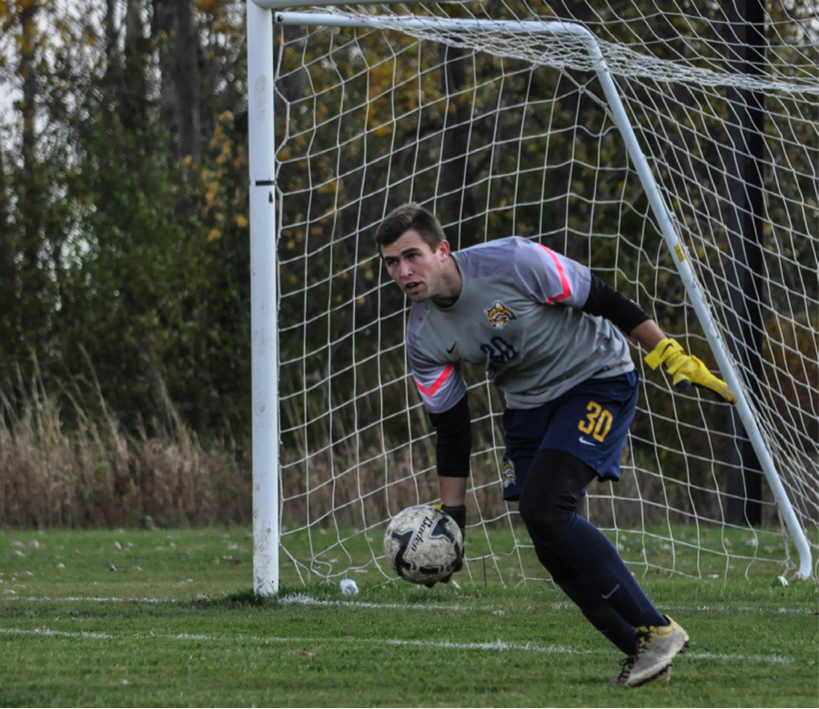 Freshman goalkeeper Colton Robison makes a save aginst Lake Michigan on Oct. 25. Photo by Nathan Gartner, Photo Editor.