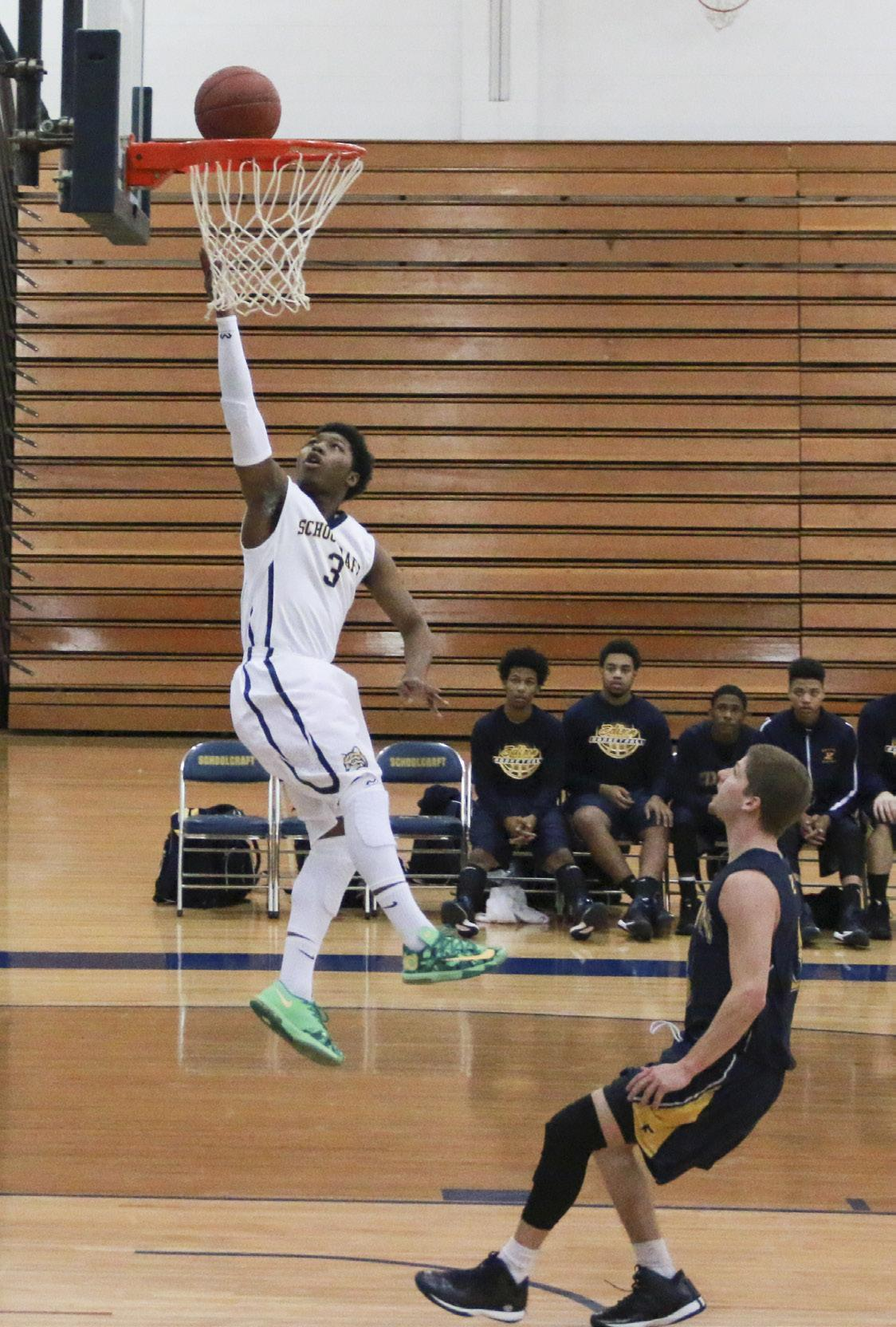 Freshman Guard Ronald Booth jumps high for a lay up against Edison State on Dec. 13. PHOTOS BY ANDREW RELLINGER  STAFF PHOTOGRAPHER