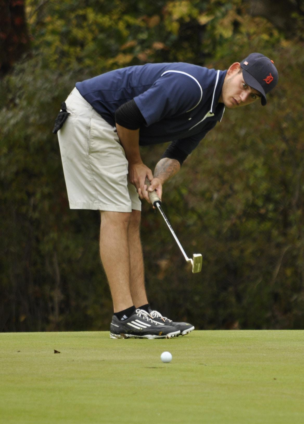 PHOTOS BY NATHAN GARTNER PHOTO EDITOR Schoolcraft sophomore Eric Perry watches on as his putt travels towards the cup in the Schoolcraft College Invitational played at Walnut Creek Country Club.