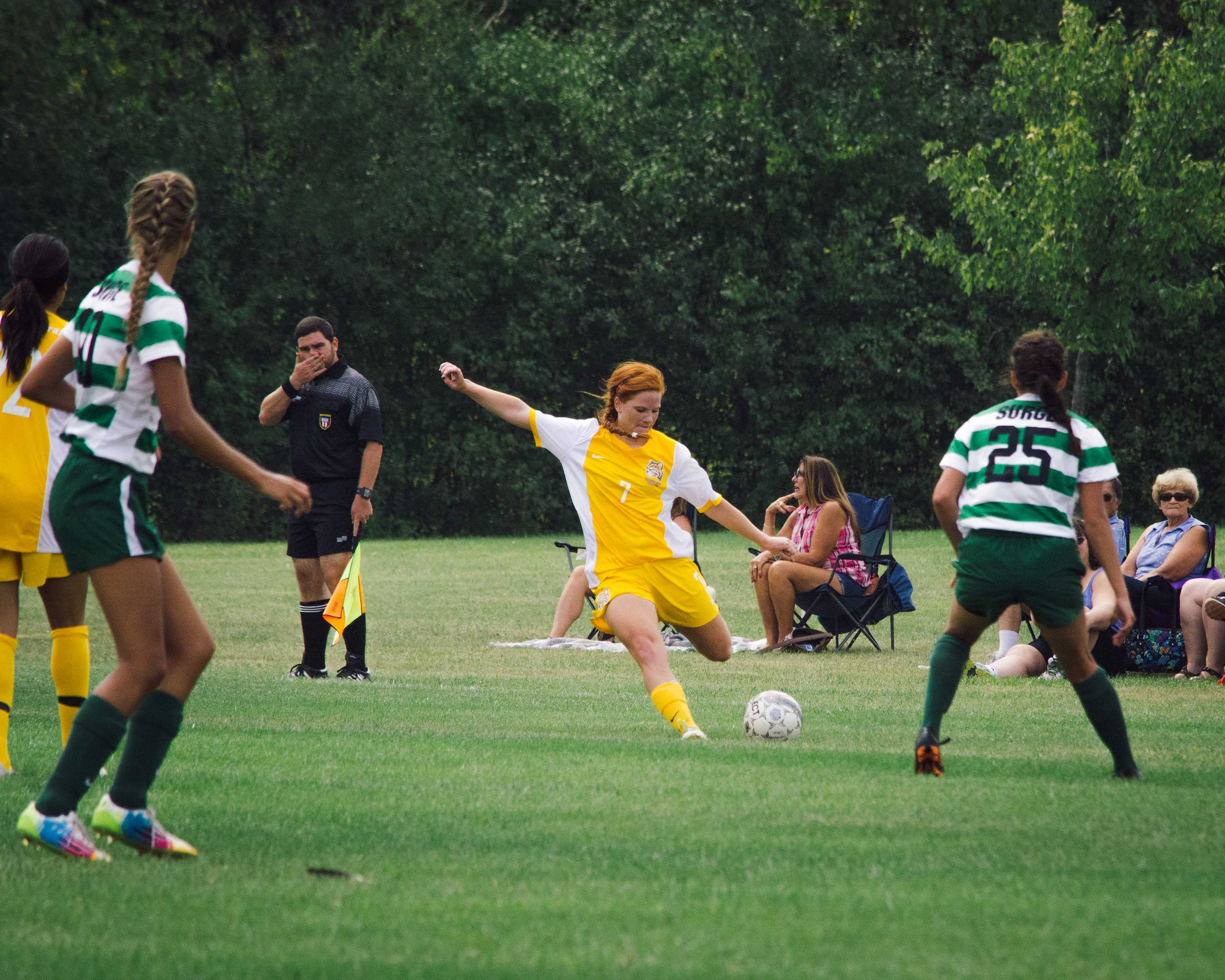 Lady Ocelot Defender, Lacey Chanady chips the ball over the opposing teams defensive players to give her fellow teammates an opportunity to score on Sunday