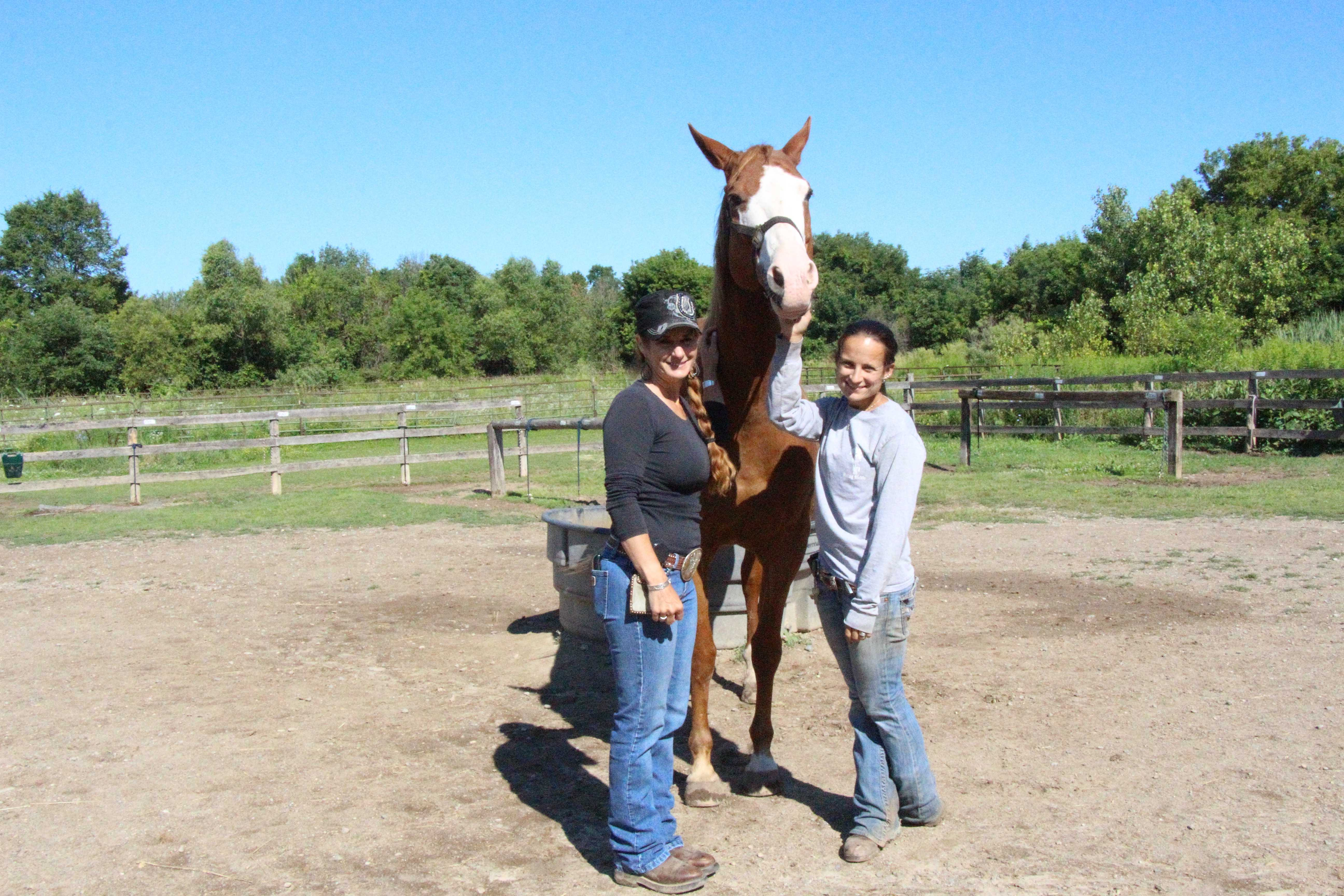 Owner Kim Hone and her daughter and manager, Cody Kafer, pose during a sunny morning at the stable.