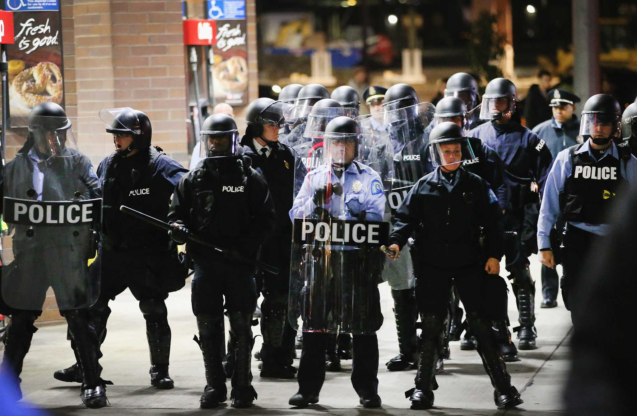 ST LOUIS, MO - OCTOBER 12:  Demonstrators protesting the killings of 18-year-olds Michael Brown by a Ferguson, Missouri Police officer and Vonderrit Myers Jr. by an off duty St. Louis police officer are confronted by police wearing riot gear on October 12, 2014 in St Louis, Missouri. The St. Louis area has been struggling to heal since riots erupted in suburban Ferguson following Brown's death.  (Photo by Scott Olson/Getty Images) ** OUTS - ELSENT, FPG - OUTS * NM, PH, VA if sourced by CT, LA or MoD **