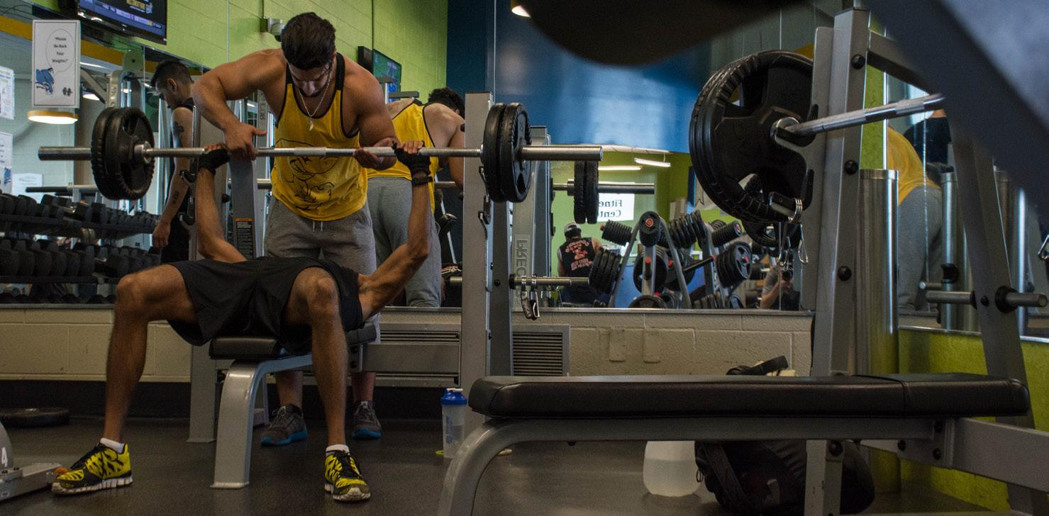 PHOTOS BY ALEX REGISH | STAFF PHOTOGRAPHER  Husam Ateyia spots Danny McBride on the bench press.