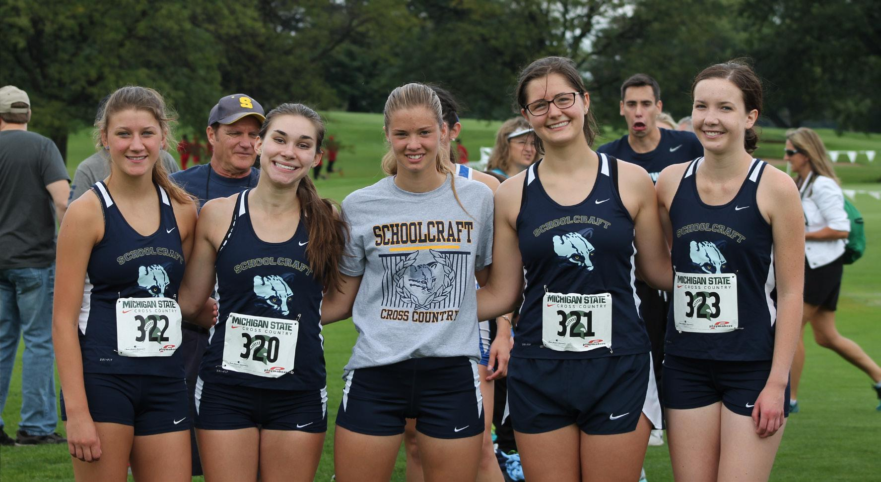 Photo courtesy of the Goyer family.  Memebers of the Women's Cross Country Team, from left to right, Freshman Lindsey Gallagher, Audrey Baetz, freshman Chelsea Kovacs, sophomore Grace Doolittle and freshman Caitlyn Goyer, pose for a photo after a recent meet.