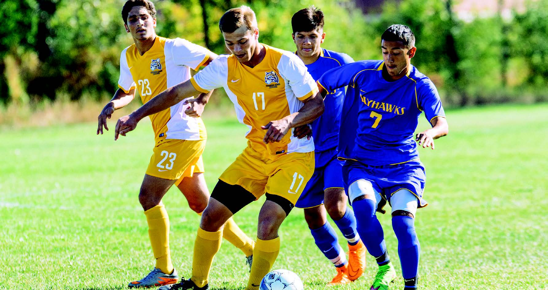 Photo by Jake Mulka | Photo Editor Sophomore Forward Jeff Drzyzga beats a Muskegon defender for possesion of the ball.