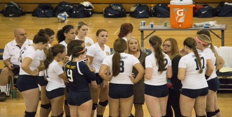 Head Coach Shannon Pummill discusses strategy with her Lady Ocelots against St. Clair County on Tuesday, Sept. 15.