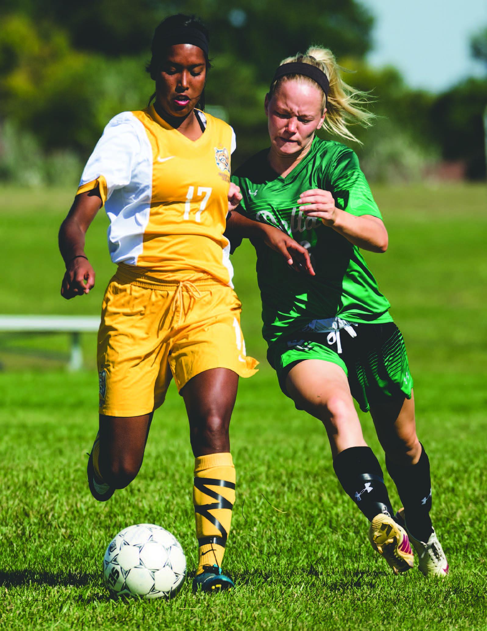 IMAGES BY JAKE MULKA | PHOTO EDITOR Sophomore Forward Cienna Rael-Whitsitt (17) battles a Delta defender for possession of the ball on Sept. 23.