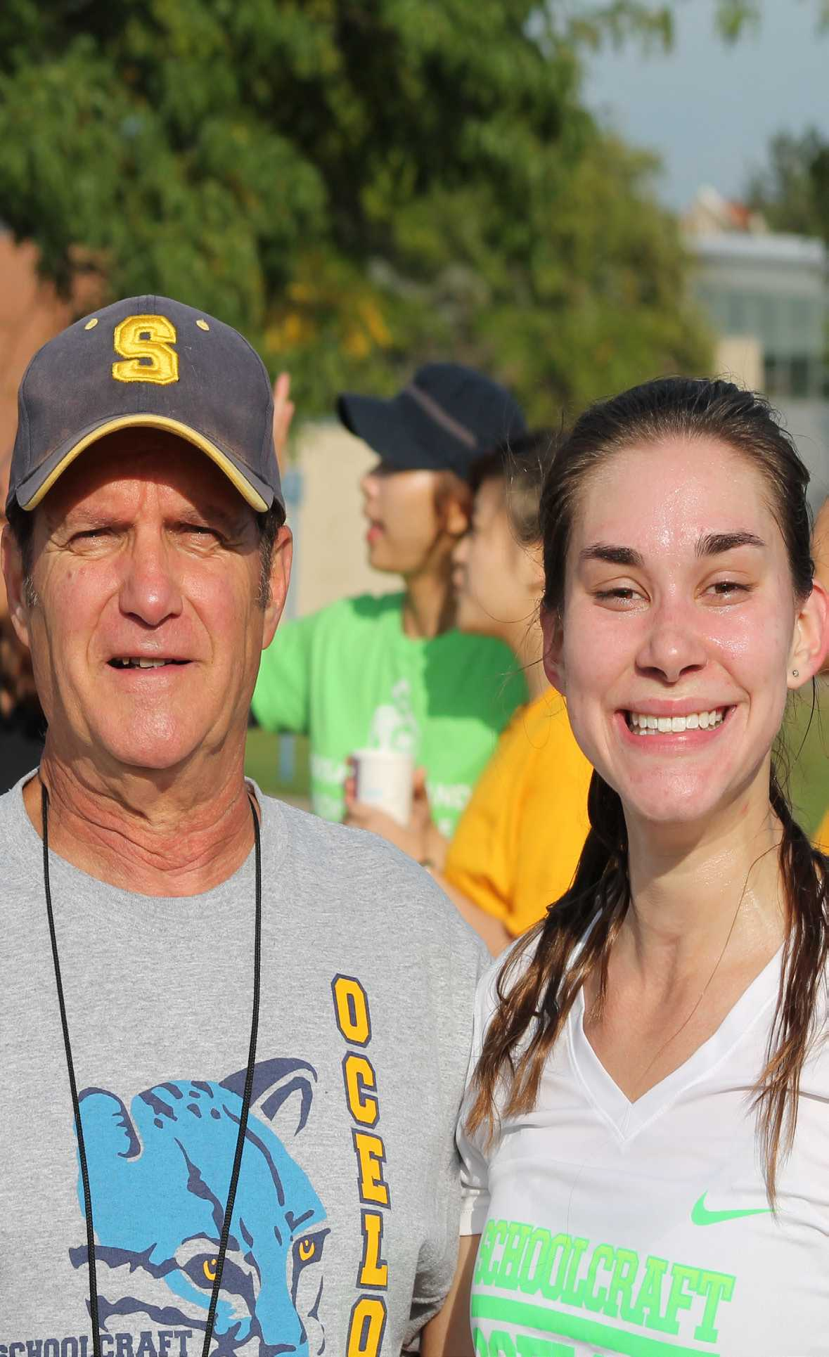 Audrey Baetz poses with Schoolcraft head coach Ed Kozloff at The Crusader 5K on Sept. 26.