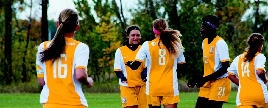 PHOTOS+BY+ALEX+REGISH+%7C+STAFF+PHOTOGRAPHER%0AThe+lady+Ocelots+celebrate+a+goal+against+Ancilla+at+Schoolcraft+College+on+Oct.+16.