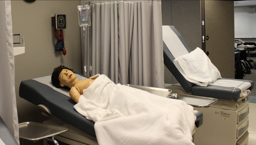 Medical Assisting students have realistic offices and mannequins to practice with.