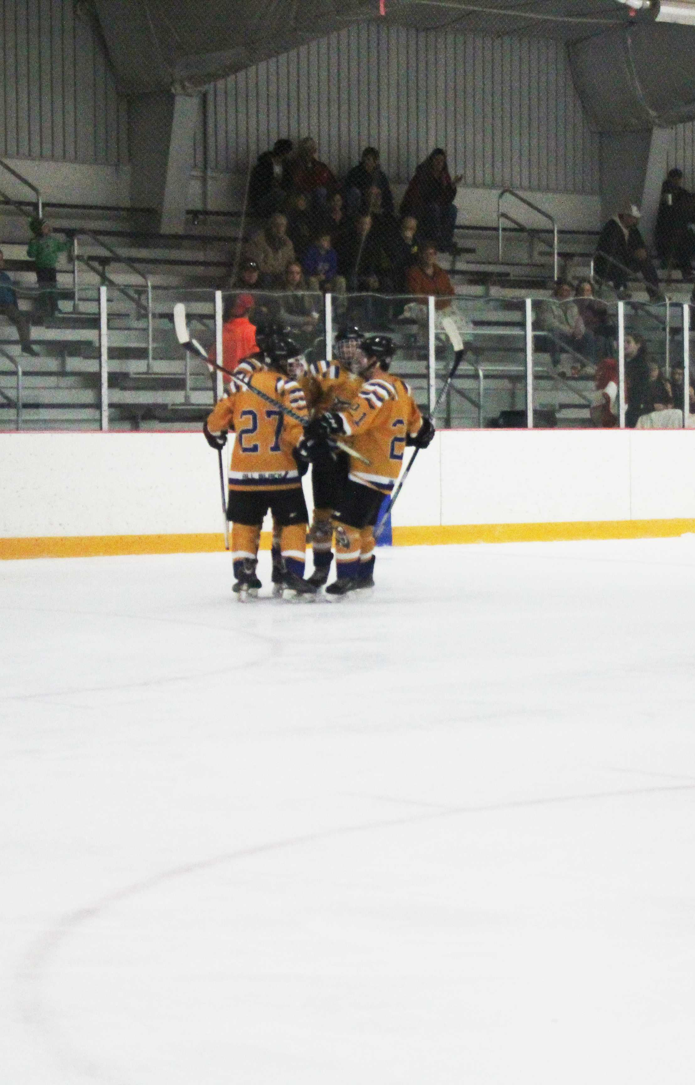 The Ocelots celebrate after the first goal of the game was made.