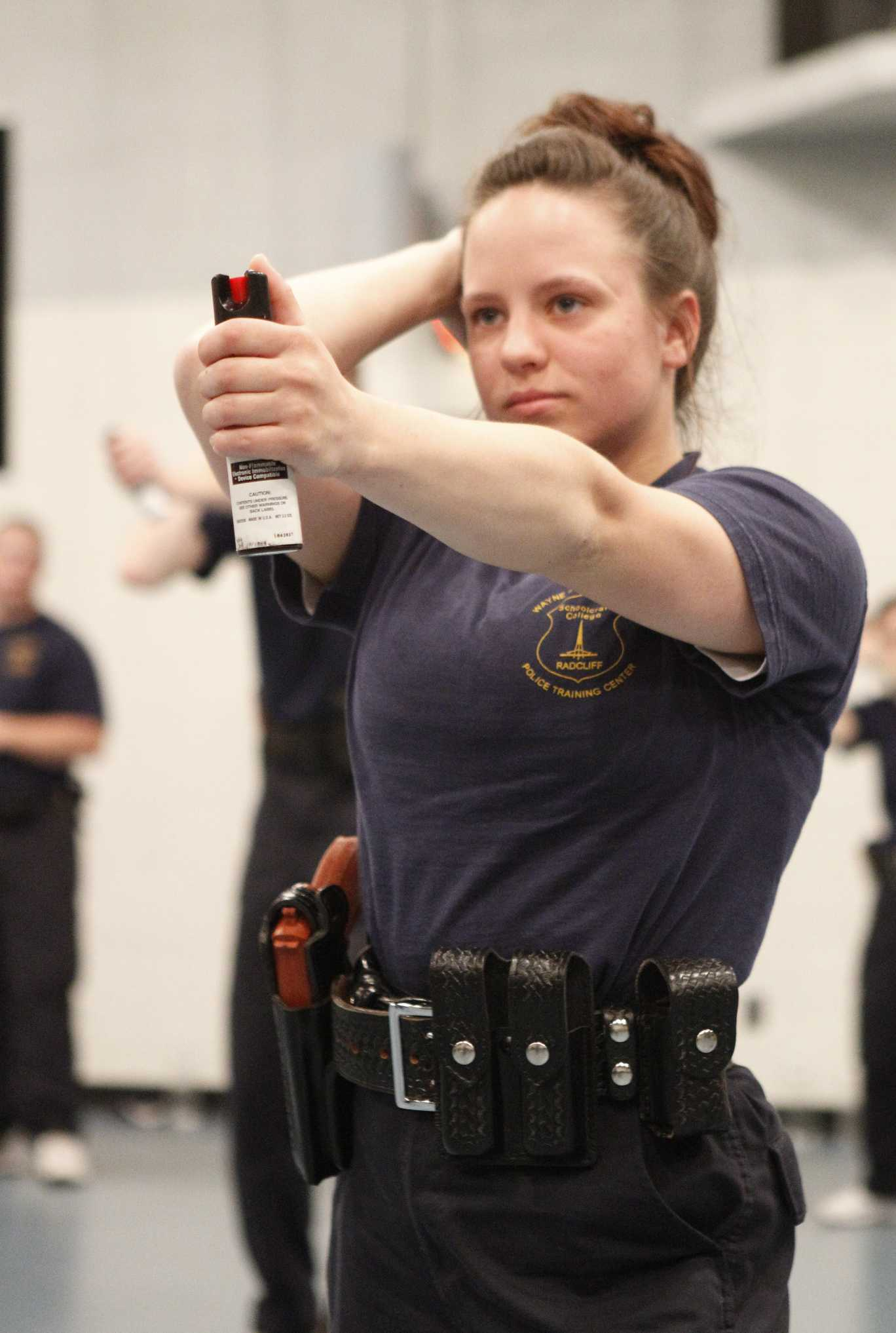 Female cadet learning self-defense techniques.