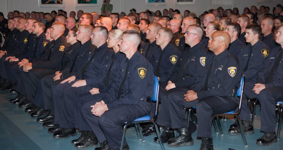 Police+Academy+recruits+listening+to+a+speaker.