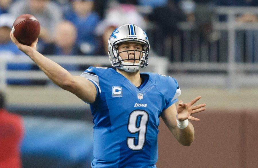 Matthew+Stafford+throwing+a+football+during+a+game.