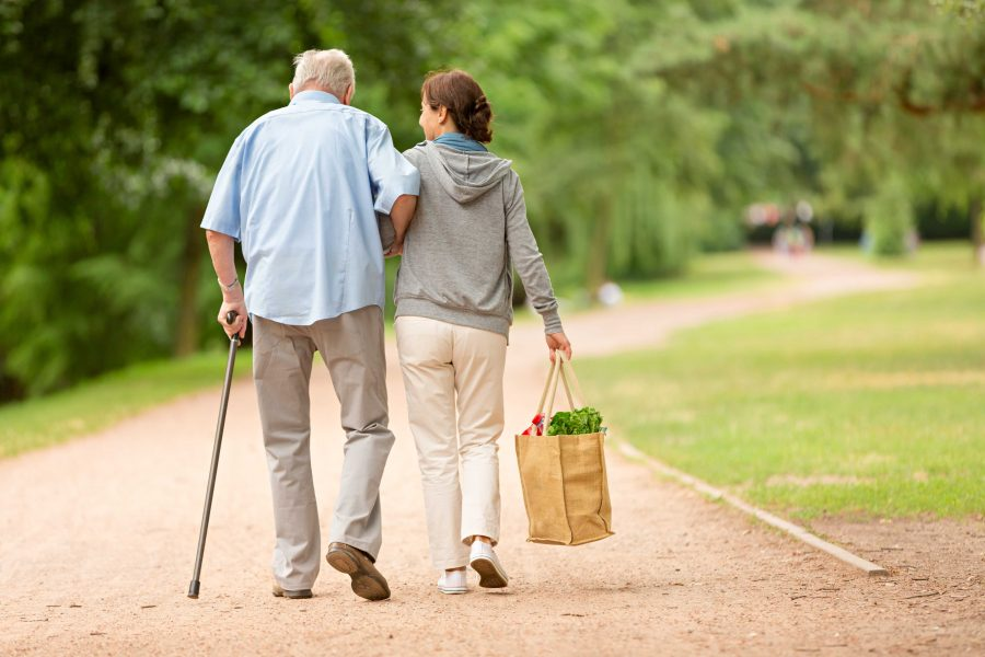 Caregiver+%E2%80%93+woman+helping+senior+man+with+shopping