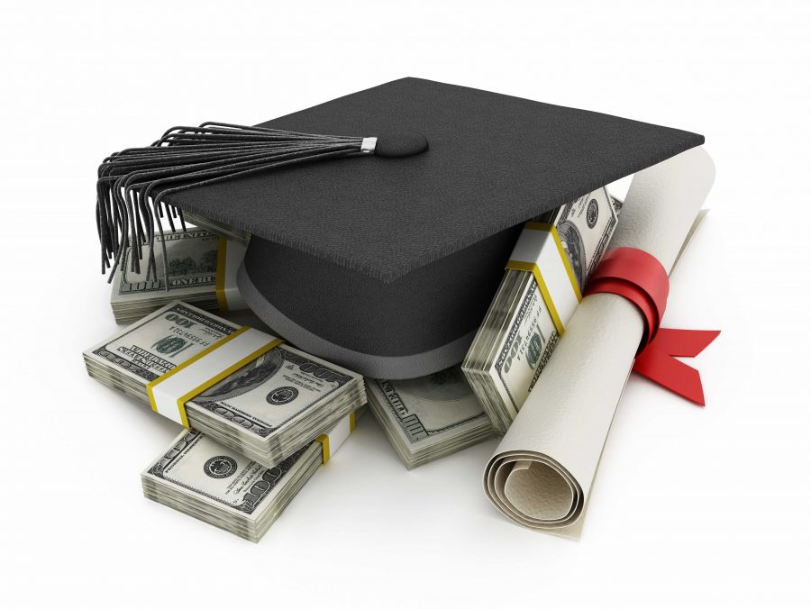 Mortarboard+and+diploma+standing+on+100+dollar+bills.