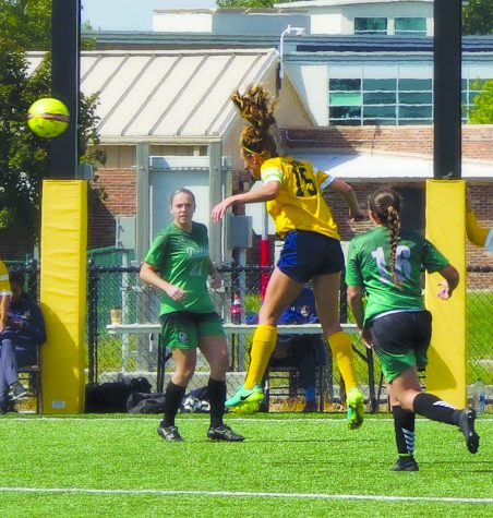 Schoolcraft's Olivia Bordorf (#15) heads the ball towards Delta's goal on September 9. (Photo By Heidi Allen, Staff Photographer.)
