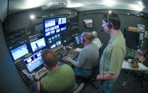 Kieth Dotson, Richard Sherby, Robert Sherby and Suzanne Sherby process footage at USA Hockey game in the new media production truck.