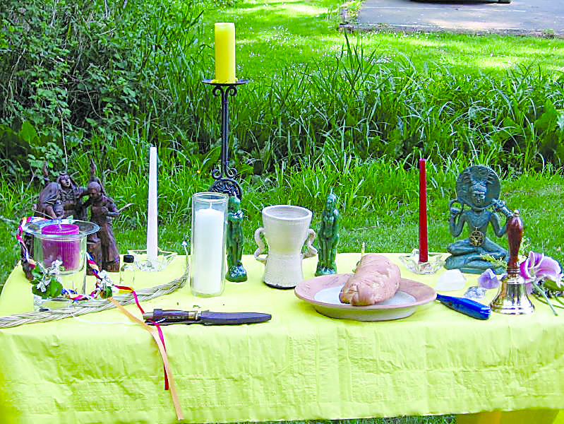 Wiccan+altars+are+typically+erected+in+lush+woodland+areas+with+various+candles%2C+offerings+to+the+Creator%2C+and+other+personal+talismans.%0A%28Image+from+Wikipedia.org%29%0A