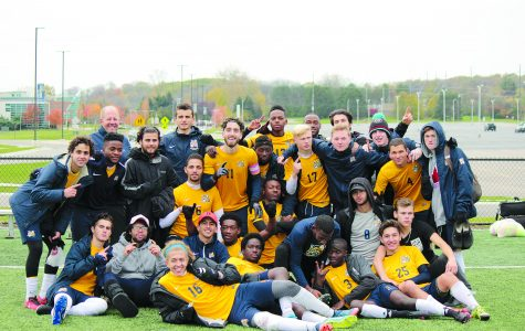 """The men's team remains undefeated, and shows off their """"number one"""" status in this team photo at the tournament championship. (Photo by David Vega, staff photographer)"""