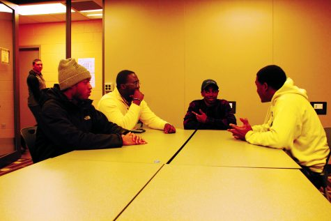 Members of The Black Student Union discuss a recent basketball game. The club is focused on social events, promoting academic achievement and helping the community. The club is open to all students, not just African-Americans. All students are encouraged to join the discussion. (Photo by Chrissy Begle Layout and Design Editor)