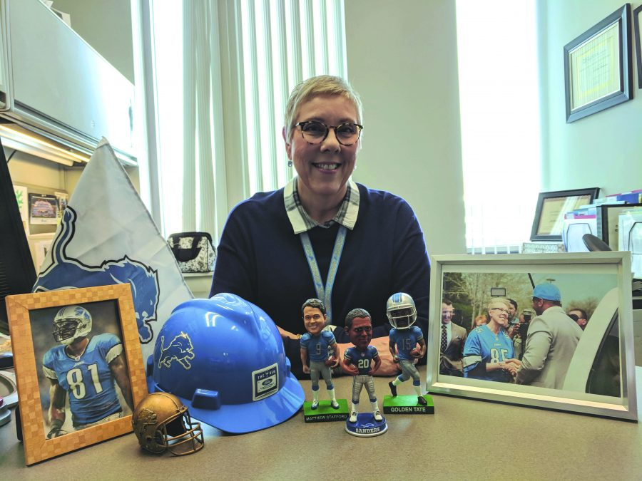 Joanne+Stadniar%2C+Career+Services+Coordinator+and+Lions+season+ticket+holder%2C+sits+among+her+Lions+memorabilia+in+her+office%2C+Friday.+Joanne+recently+one+a+complimentary+trip+to+Minneapolis+for+Super+Bowl+LII+because+of+her+faithful+support+of+the+Lions.%0A%28Image+by+Kevin+T.+Ferguson%2C+Assistant+Layout+Editor%29
