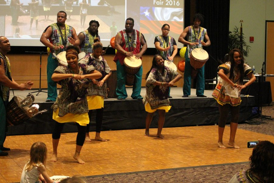 Many performances from diverse cultural groups will take place throughout the Multicultural Fair and are one of the highlights of the event. Displays with cultural artifacts, food samples and more help attendees experience a little bit of world travel without leaving their corner of the world. Raffles, vendors, free massages and henna painting add a special touch. (Image from Student Activities Archives)