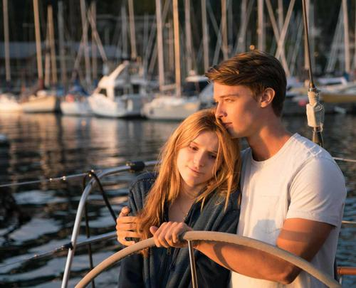 Katie Price (Bella Thorne) is a teen who suffers from xeroderma pigmentosum (XP), a skin condition that makes sunlight lethal to her. Her life changes when she meets Charlie (Patrick Schwarzenegger) and their romance can only exist beneath the Midnight Sun. (Image from fandango.com)