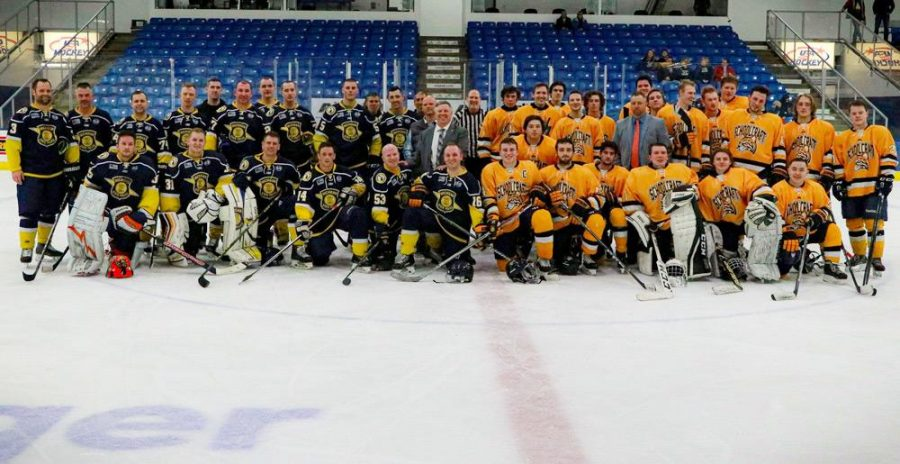 Members+of+the+Schoolcraft+College+and+Michigan+State+Troopers+%28MSP%29+Hockey+teams+gather+at+center+ice+for+a+group+photo+at+the+conclusion+of+the+game.+The+MSP+Troopers+beat+the+Ocleots+8-3.