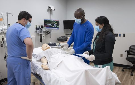 First year Emergency Medicine Residents at Livonia's St. Mary Mercy Hospital practice a medical scenario on a SIM lab patient on Wednesday, June 24, 2020.