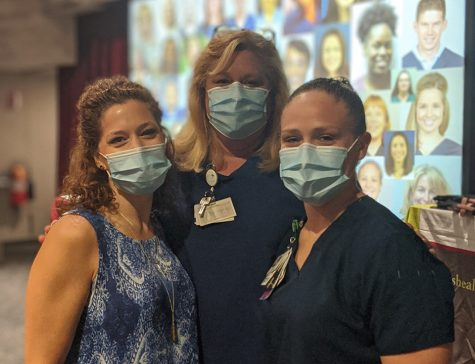 Schoolcraft Alumna Nikki Borgert (left) pictured with colleagues received St. Joe's Ann Arbor Nurse of the Year thanks to her dedication and service to the patients she faithfully aids every day. (photo courtesy of Nikki Bogart)