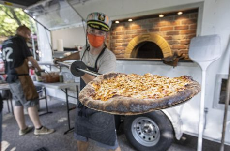 Nick Mannisto shows off his cheese pizza he created in his mobile food truck. (Courtesy Photos)