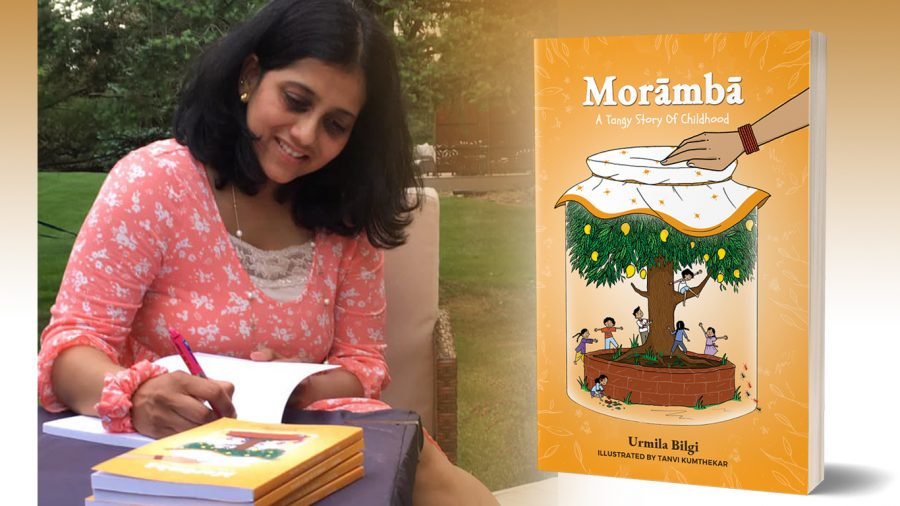 Schoolcraft Alumna, Urmila Bilgi autographs her childrens book, Morāmbā which was published March 24, 2021.